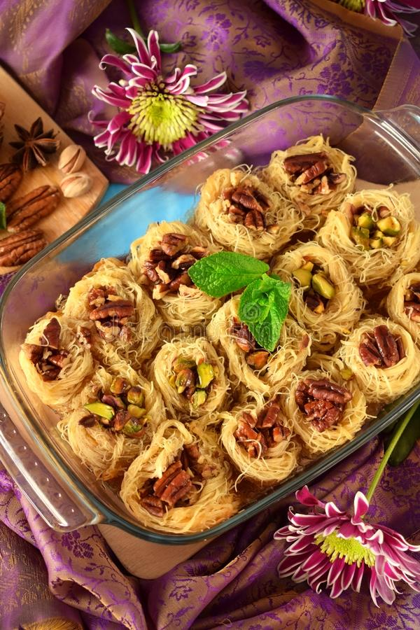 Egyptian dessert Kunafa with pistachio and pecan nuts royalty free stock images