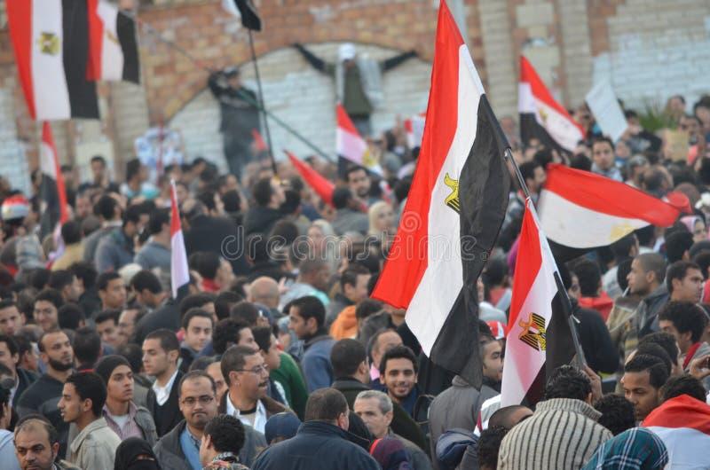 Egyptian flag on the demonstrators on January 25 royalty free stock image