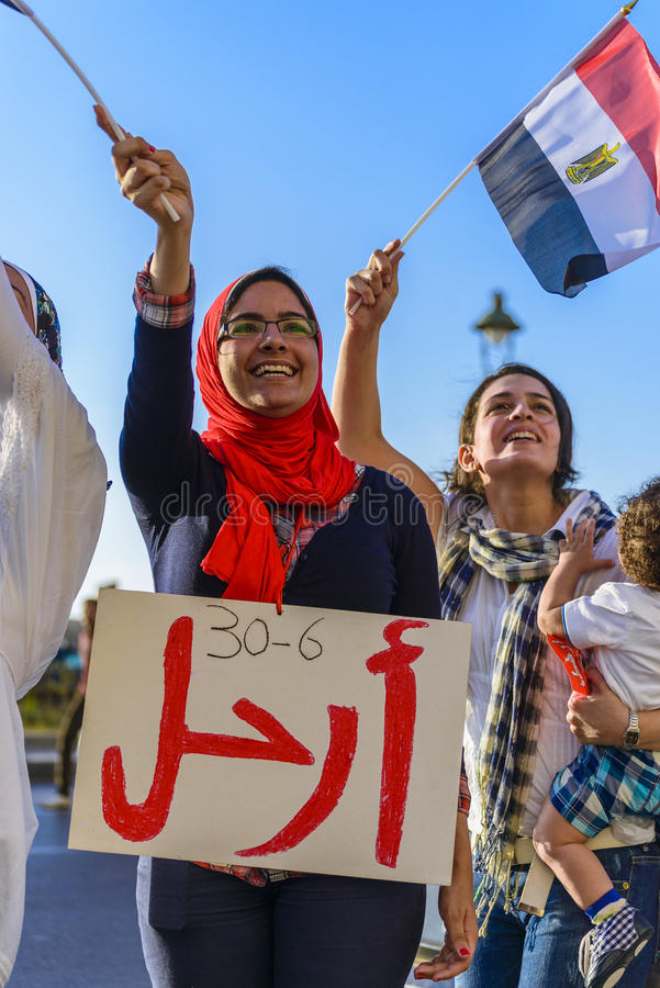 Egyptian Girl Protesting with LEAVE Sign stock image