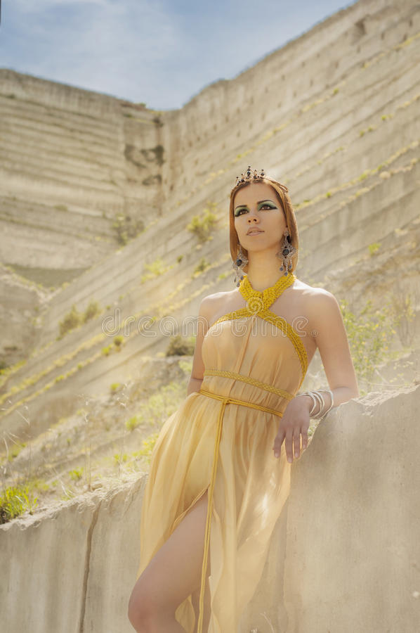 Egyptian. An Egyptian girl stands in a desert oasis royalty free stock photo