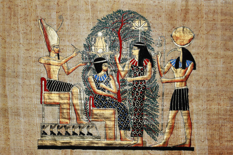 Egyptian gold drawing on papyrus stock photos
