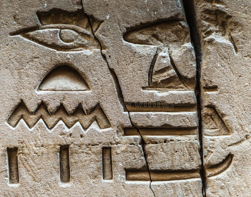 Egyptian hieroglyphs. Well preserved authentic real Egyptian hieroglyphs on the wall in a temple stock photos