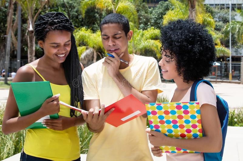Egyptian male student with other african american students stock photography