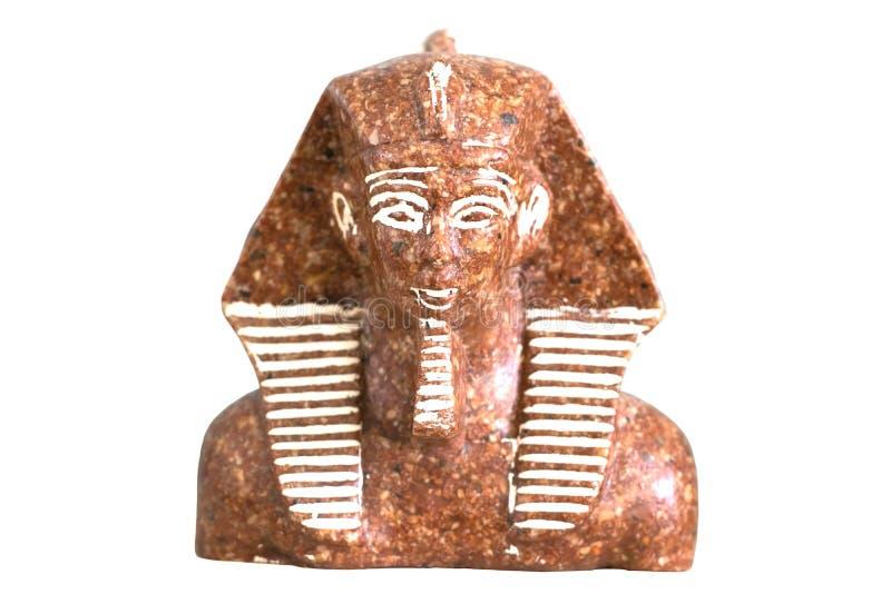 Egyptian Pharaoh Tutankhamun figurine. Stone figurine of Egyptian Pharaoh Tutankhamun on isolated white background. Famous funeral mask. Souvenir in memory of a royalty free stock photography