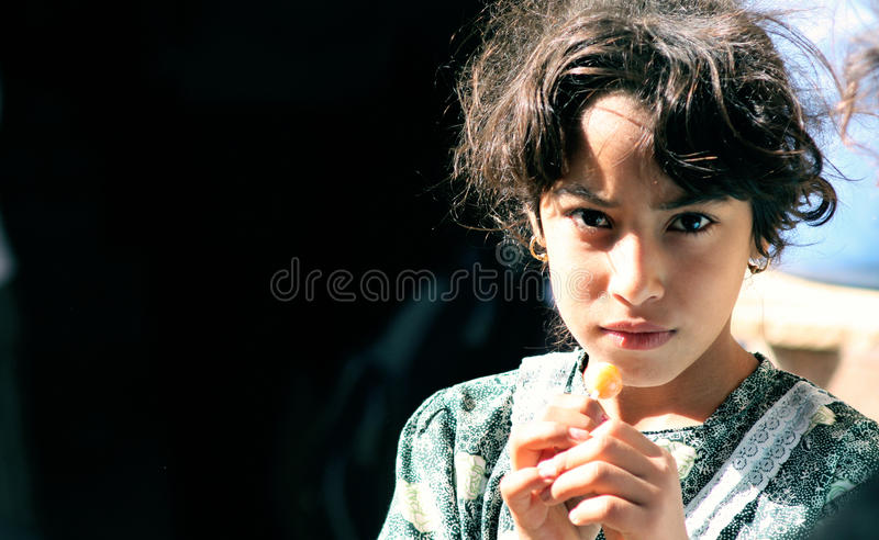 Poor girl in egypt. Egyptian Poor girl searching for happiness in cairo in egypt stock image