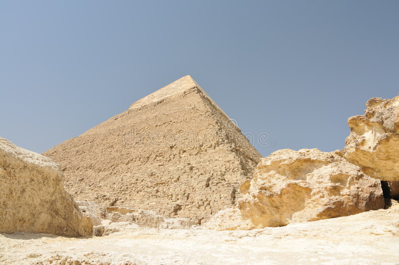Egyptian pyramid and rocks royalty free stock photography