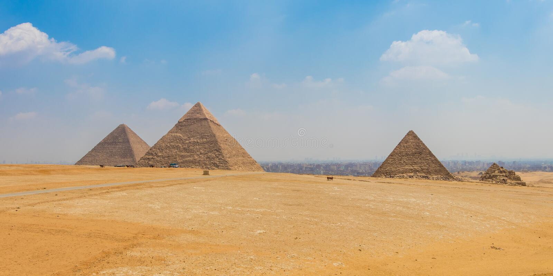 Egyptian pyramids with a beautiful sky at Giza stock photos