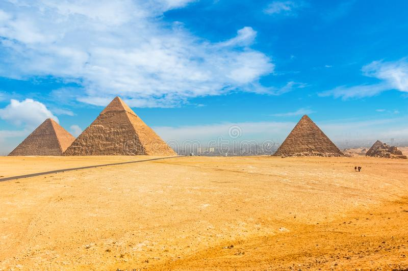 The Egyptian pyramids of Giza on the background of Cairo. Miracle of light. Architectural monument. The tombs of the pharaohs. Va. Cation holidays background stock images