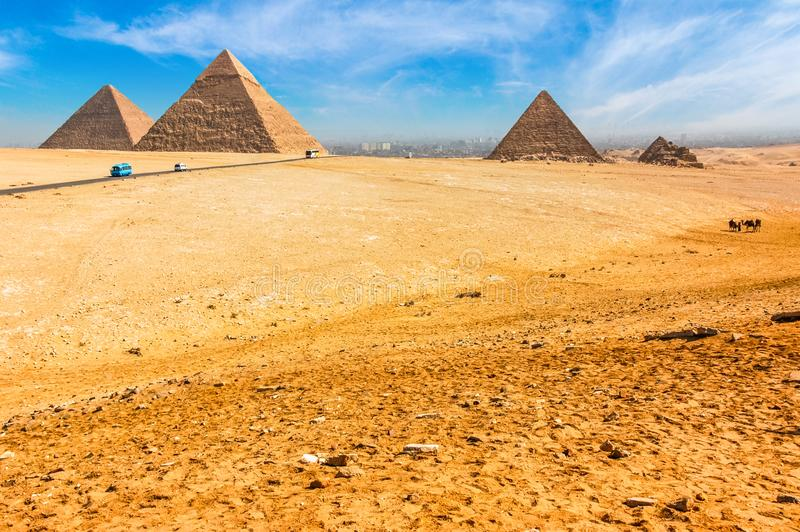The Egyptian pyramids of Giza on the background of Cairo. Miracle of light. Architectural monument. The tombs of the pharaohs. Va royalty free stock image