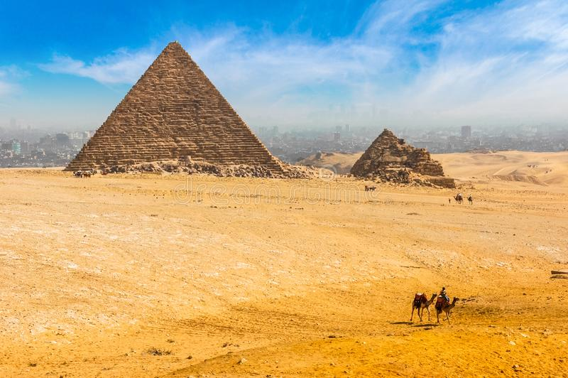 The Egyptian pyramids of Giza on the background of Cairo. Miracle of light. Architectural monument. The tombs of the pharaohs. Va. Cation holidays background stock photos