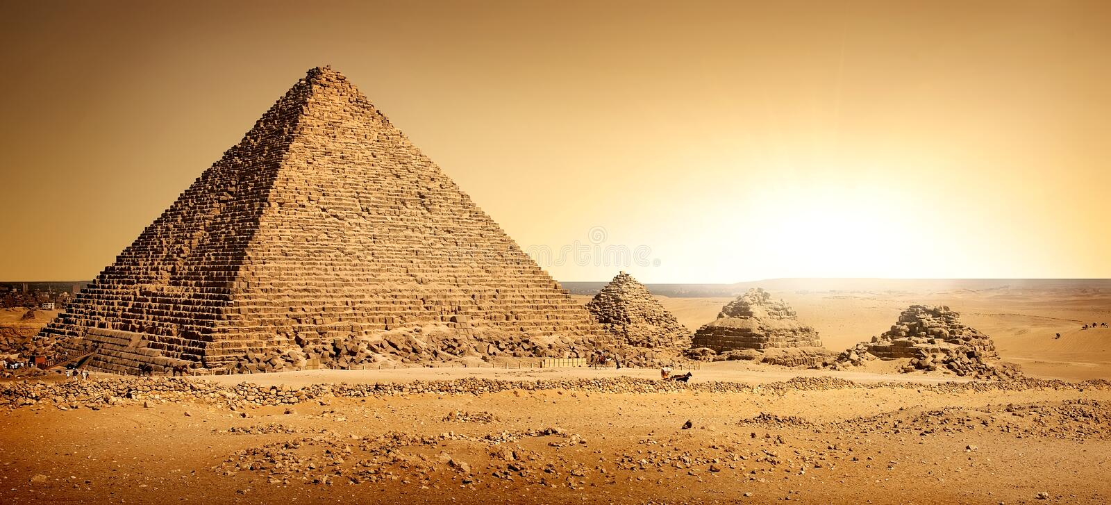Egyptian pyramids in sand stock images