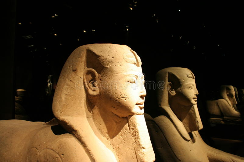 Egyptian sculpture. Ancient Egyptian sculpture in the dark background royalty free stock photo