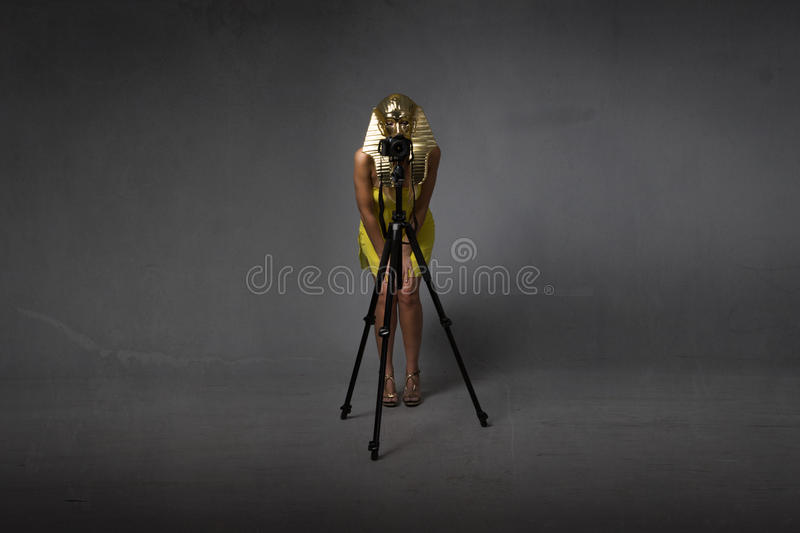 Egyptian sphynx taking picture with tripod royalty free stock photo