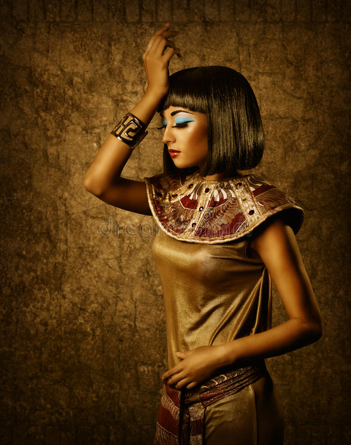 Egyptian style woman, bronze cleopatra portrait. Beautiful egyptian style woman, bronze cleopatra portrait over golden background stock image