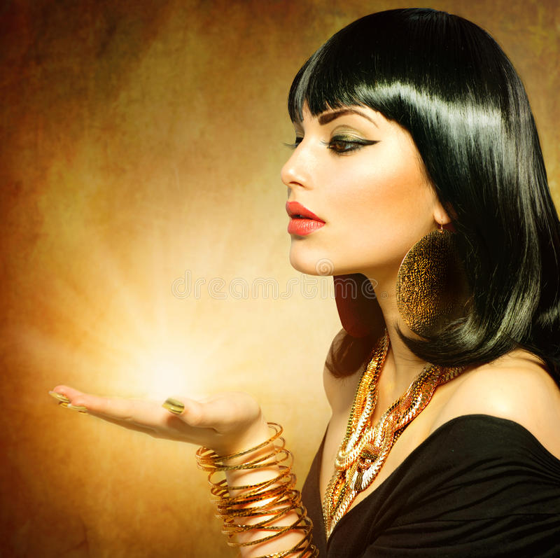 Egyptian Style Woman. With Magic Light in Her Hand royalty free stock photos