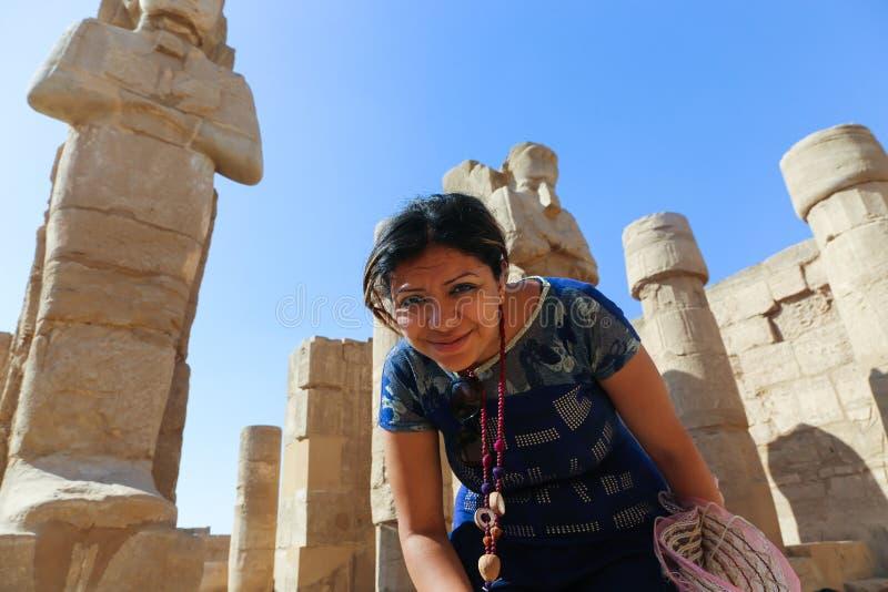 Egyptian woman at Karnak Temple at Luxor - Egypt. Architecture of Karnak Temple at Luxor - Egypt Karnak temple most huge temple at Egypt royalty free stock image