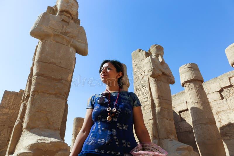 Egyptian woman at Karnak Temple at Luxor - Egypt. Architecture of Karnak Temple at Luxor - Egypt Karnak temple most huge temple at Egypt stock image