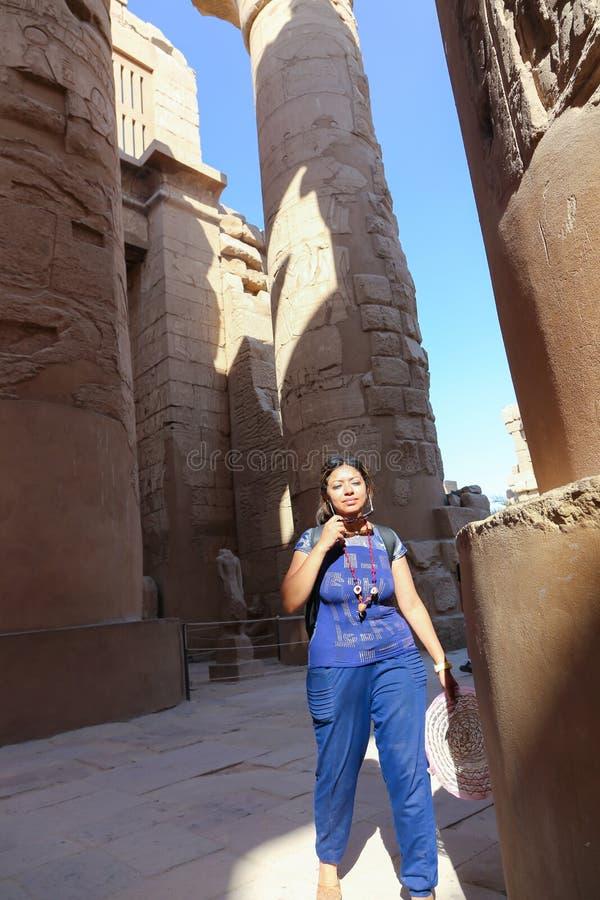 Egyptian woman at Karnak Temple at Luxor - Egypt. Architecture of Karnak Temple at Luxor - Egypt Karnak temple most huge temple at Egypt stock photo