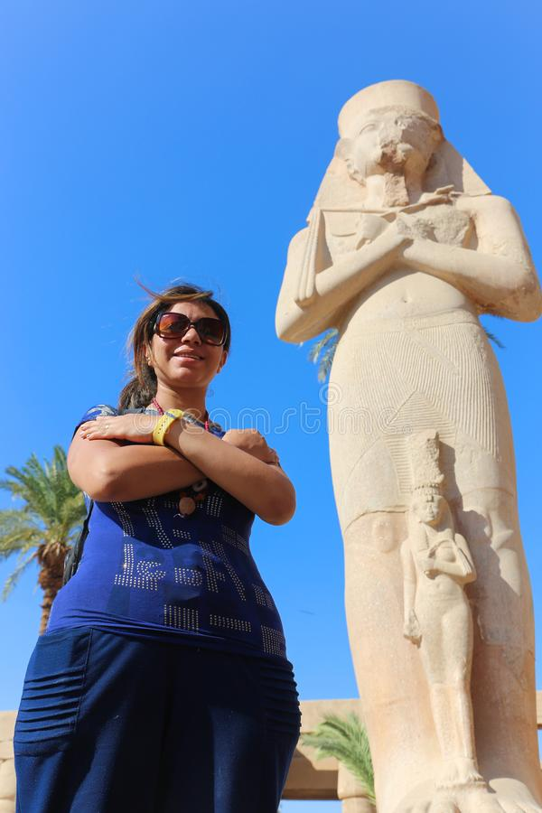 Egyptian woman at Karnak Temple at Luxor - Egypt. Architecture of Karnak Temple at Luxor - Egypt Karnak temple most huge temple at Egypt royalty free stock photo