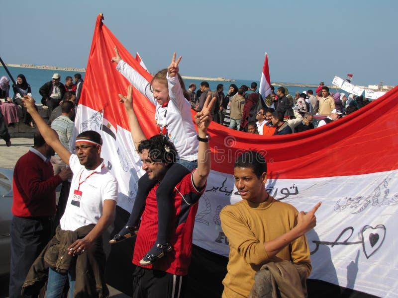 Egyptians celebrating the resignation of President stock photography