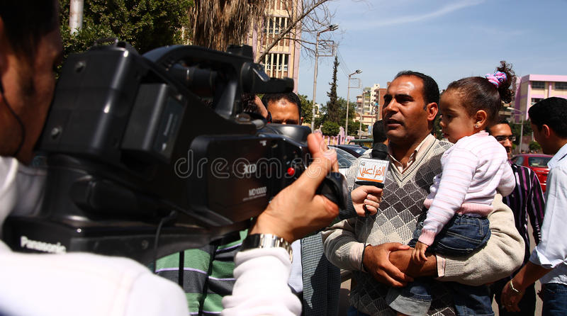 Egyptians opinions on constitutional reforms. A TV channel correspondent interviewing and Egyptian man asking him about his opinion about the constitutional royalty free stock photography