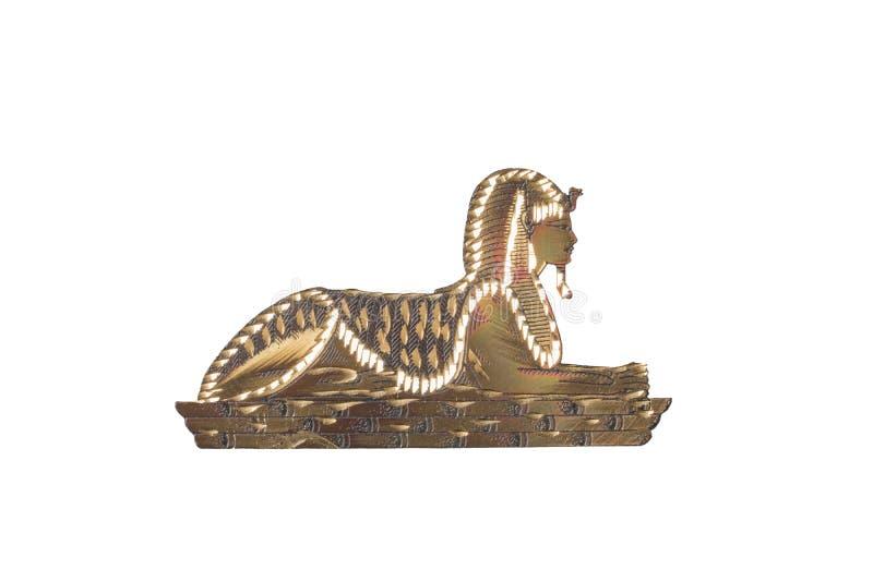 egyptisk sphinx Den guld- egyptiska sfinxen från metalliskt material är arkivfoton