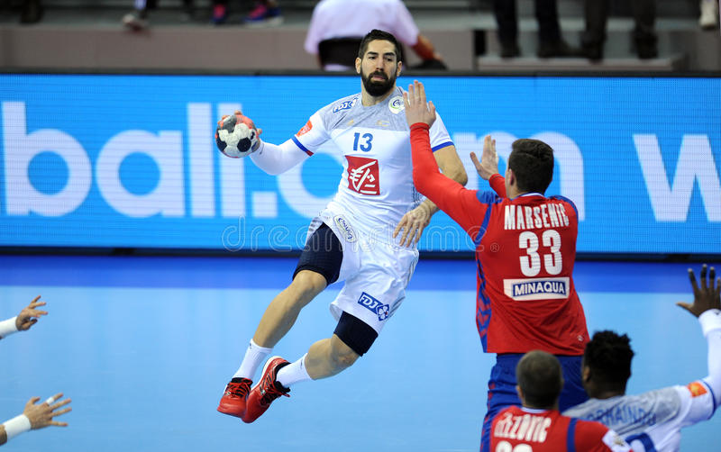EHF EURO 2016 France Serbia. CRACOV, POLAND - JANUARY 17, 2016: Men's EHF European Handball Federation EURO 2016 Krakow Tauron Arena Serbia France o/p: Nikola stock photos