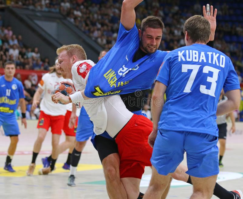 EHF EURO 2020 Qualifiers handball game Ukraine v Denmark. KYIV, UKRAINE - JUNE 12, 2019: Anders ZACHARIASSEN of Denmarkin White  attacks during the EHF EURO 2020 royalty free stock photo