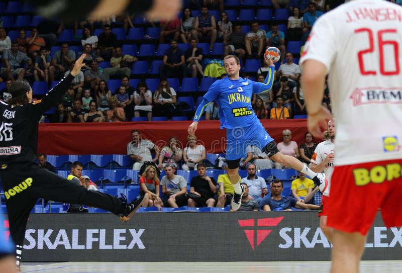EHF EURO 2020 Qualifiers handball game Ukraine v Denmark. KYIV, UKRAINE - JUNE 12, 2019: Andrii AKIMENKO of Ukraine throws a ball during the EHF EURO 2020 royalty free stock photo