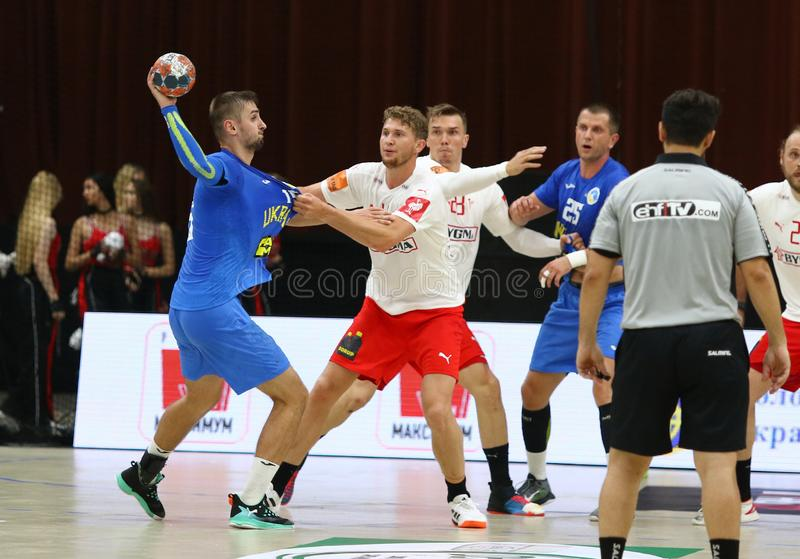 EHF EURO 2020 Qualifiers handball game Ukraine v Denmark. KYIV, UKRAINE - JUNE 12, 2019: Ukraine in Blue and Denmark handball players fight for a ball during stock photos