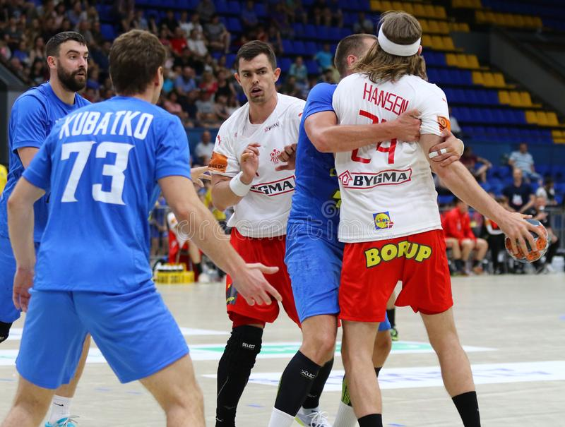EHF EURO 2020 Qualifiers handball game Ukraine v Denmark. KYIV, UKRAINE - JUNE 12, 2019: Ukraine in Blue and Denmark handball players fight for a ball during stock image