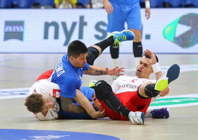 EHF EURO 2020 Qualifiers handball game Ukraine v Denmark. KYIV, UKRAINE - JUNE 12, 2019: Ukraine in Blue and Denmark handball players fight for a ball during royalty free stock image