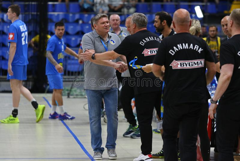 EHF EURO 2020 Qualifiers handball game Ukraine v Denmark. KYIV, UKRAINE - JUNE 12, 2019: Head coach Sergej BEBESHKO of Ukraine L shakes hand to Nikolaj JACOBSEN stock photography