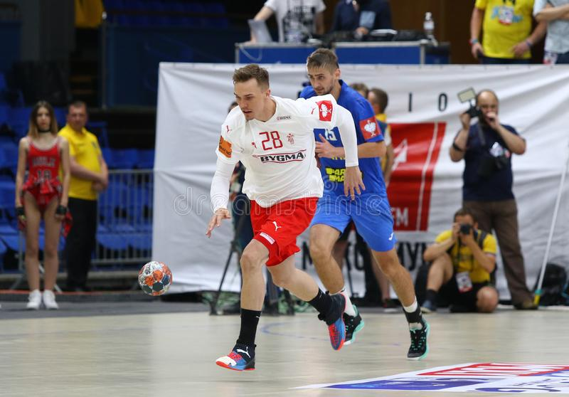 EHF EURO 2020 Qualifiers handball game Ukraine v Denmark. KYIV, UKRAINE - JUNE 12, 2019: Lasse Bredekjaer ANDERSSON of Denmark controls a ball during the EHF royalty free stock photo