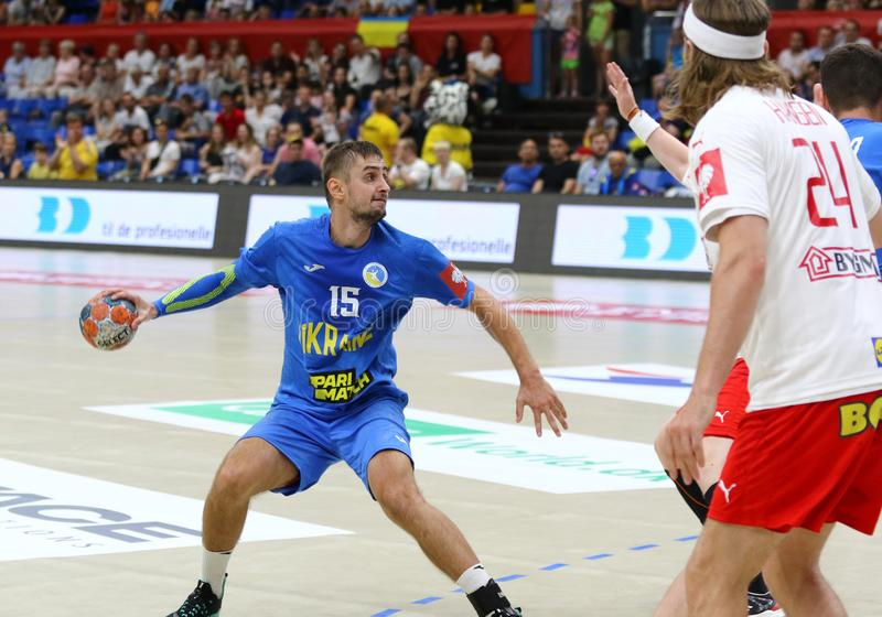 EHF EURO 2020 Qualifiers handball game Ukraine v Denmark. KYIV, UKRAINE - JUNE 12, 2019: Oleksandr TILTE of Ukraine controls a ball during the EHF EURO 2020 royalty free stock image