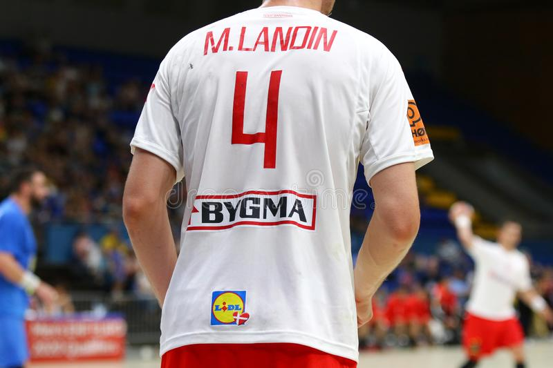 EHF EURO 2020 Qualifiers handball game Ukraine v Denmark. KYIV, UKRAINE - JUNE 12, 2019: Sponsors logos on the jersey of player Magnus LANDIN JACOBSEN of Denmark stock image