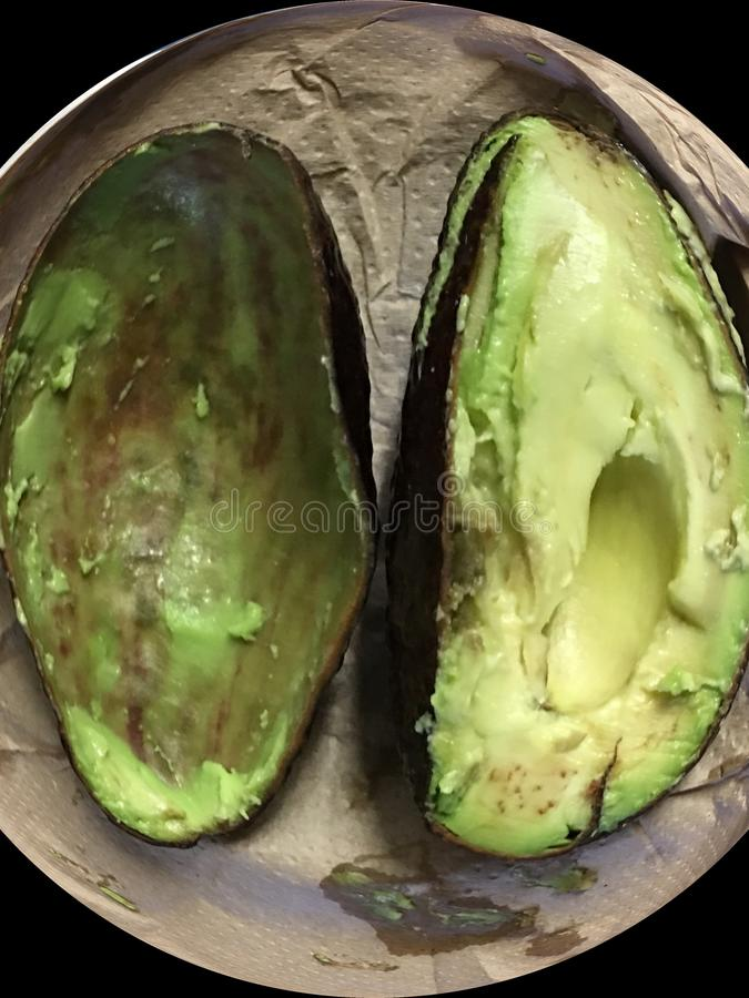 Ehrfürchtige, prachtvolle Avocado, die genossen wird stockfotografie