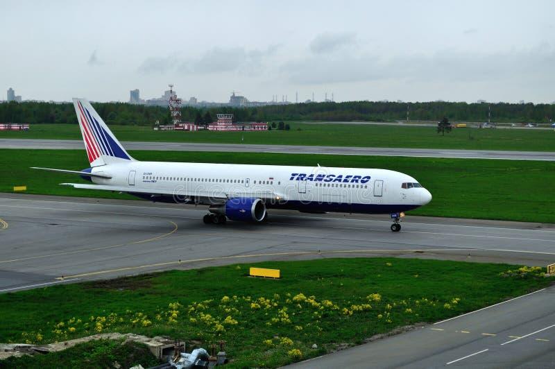 EI-UNB Transaero Airline Boeing 767-3P6ER airplane prepares for takeoff from the runway of Pulkovo International Airport. Saint Petersburg, Russia - May 23,2015 royalty free stock image