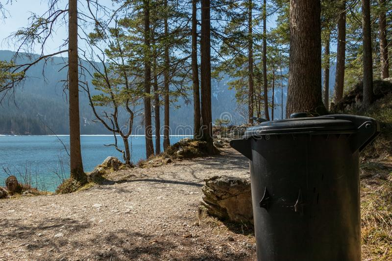 Eibsee, Germany, March 31, 2019: trash can next to the seeweg loop track. The trash cans are spread all over the place to keep it royalty free stock image
