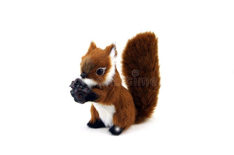 Eichhörnchen mit seiner Nuss lizenzfreies stockbild