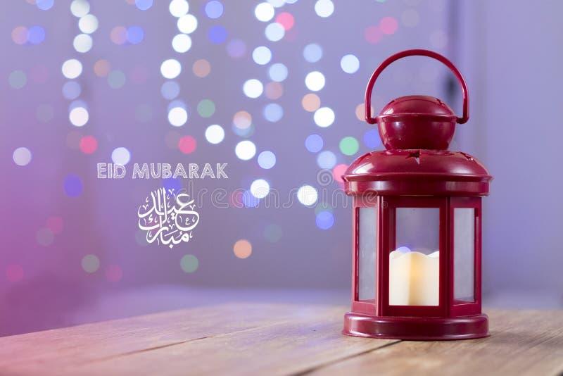 Eid al-Fitr Mubarak Greeting Typography with Bokeh backgound. Arabic lantern on wooden backgound. Eid al-Fitr Mubarak Greeting Typography with Bokeh backgound royalty free stock images