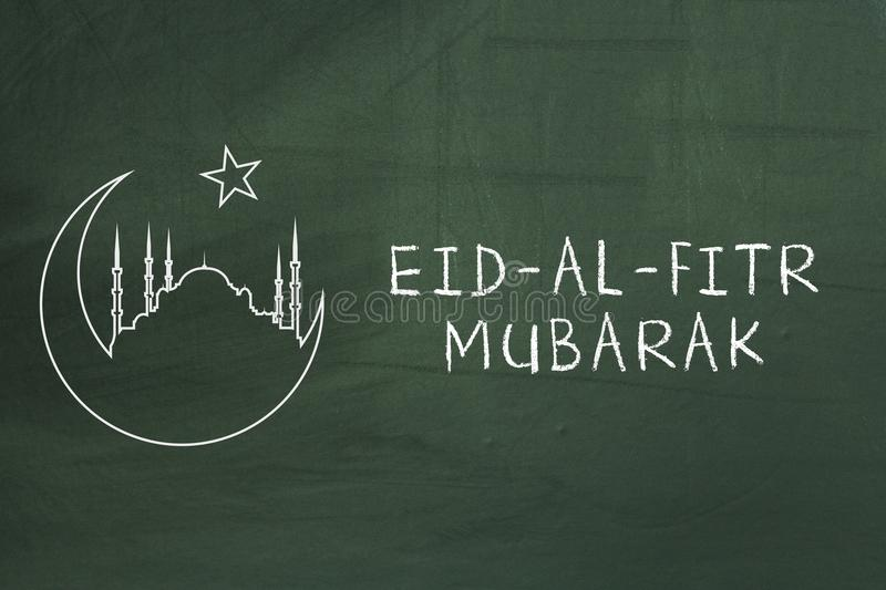 Eid-Al-Fitr mubarak text on green blackboard. Welcoming ramadan. stock images