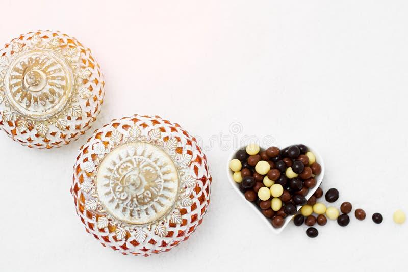 Eid Mubarak greeting with Eid Al Adha sacrifice festival, Islamic Arabic candle and sweet chocolate sugars. Eid Mubarak greeting with Eid Al Adha sacrifice stock photography
