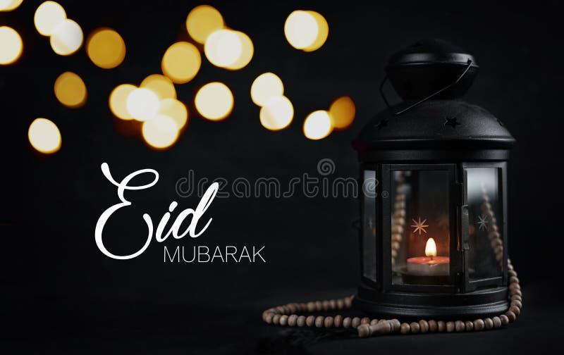 Eid Mubarak Greeting Typography Beautiful Bokeh. Ramadan Candle. Lantern with Wooden Prayer Beads stock images