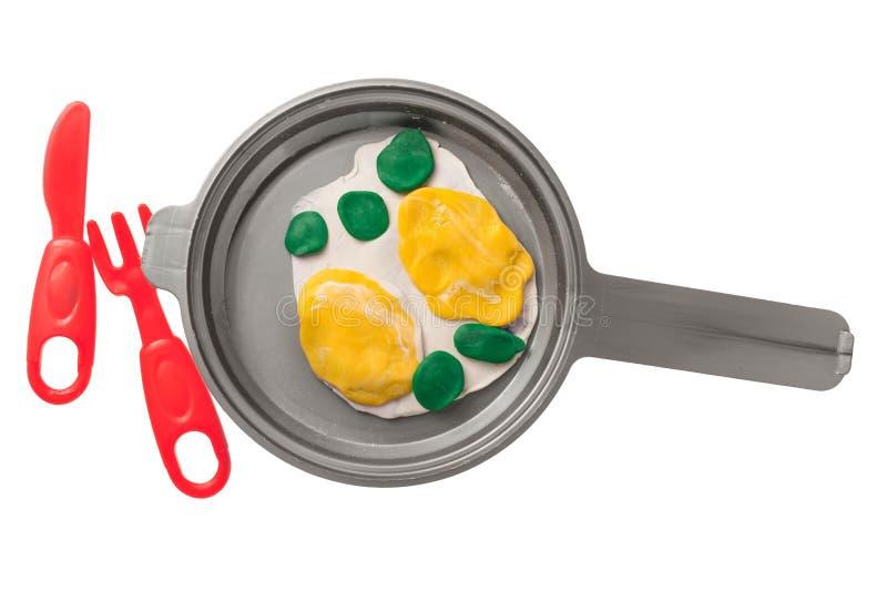 Eier aus Kunststoff in einer Pfanne lizenzfreie stockfotografie