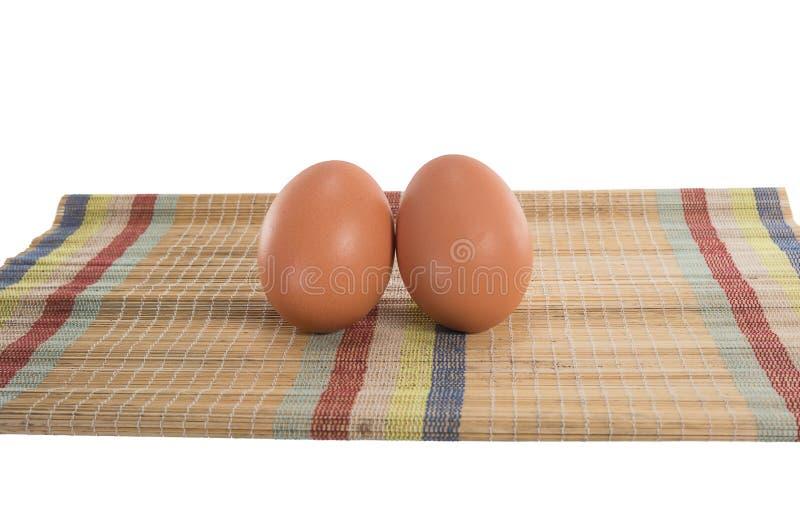 Eieren op de mat stock afbeelding