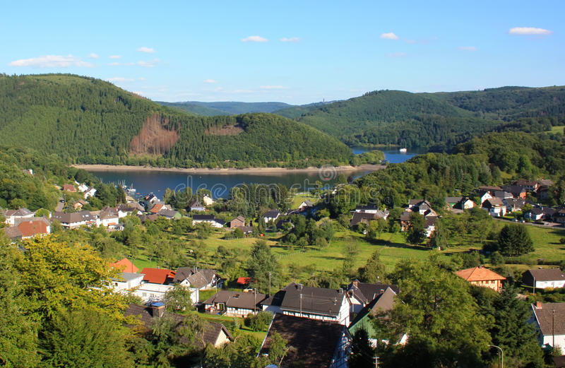 Eifel Park. Bird View to Lake in Eifel Park, small Village and Moutains royalty free stock images
