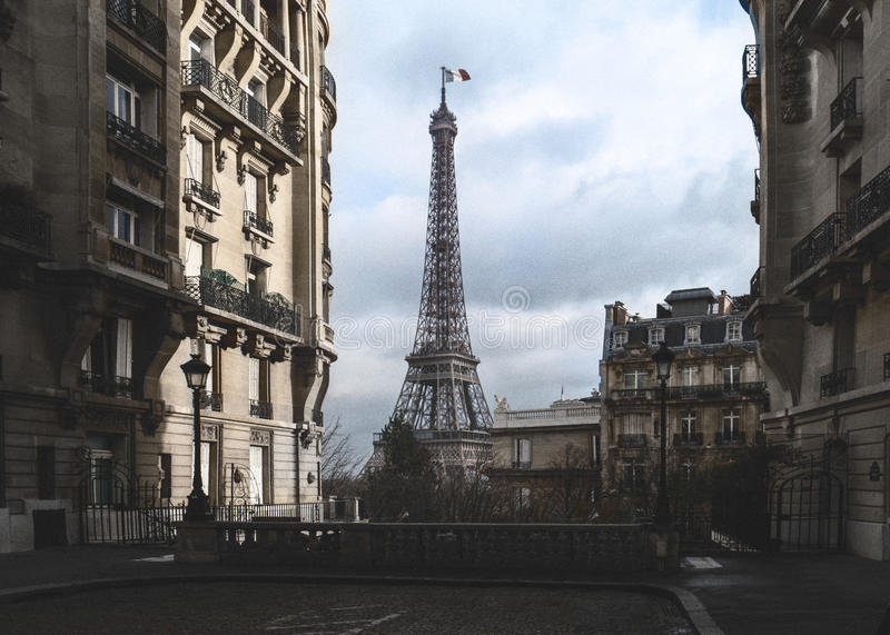 The eifel tower in Paris from a tiny street stock photography