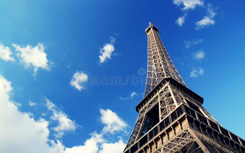 Eiffel tower against blue sky royalty free stock photo