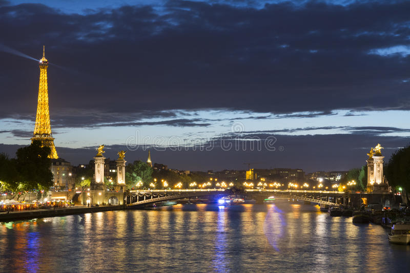 Eiffel Tower and Alexander III Bridge at night. stock photo